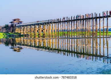 MANDALAY, MYANMAR - FEB 20, 2017: Royalty high quality free stock image of silhouettes of people on Bridge U-Bein teak bridge is the longest. in Amarapura ,Mandalay ,Myanmar