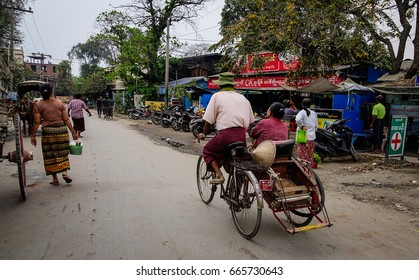 Mandalay, Myanmar - Feb 25, 2016. People and vehicles at local market in Mandalay, Myanmar. Mandalay is the second largest city in Burma, and a former capital of Myanmar.