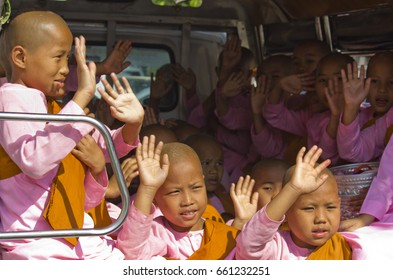 MANDALAY, MYANMAR - FEBRUARY 27 2014: Little girl monks in a van After visiting the market asking for charity, little monks go back to the Monastery, greeting the people