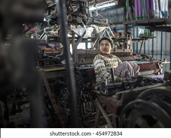 MANDALAY, MYANMAR - JANUARY 11, 2016: Unidentified woman in a small silk factory on the outskirts of Mandalay, Myanmar on January 11, 2016