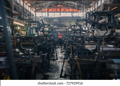 MANDALAY, MYANMAR - JANUARY 11, 2016: Unidentified man in a small silk factory on the outskirts of Mandalay, Myanmar on January 11, 2016