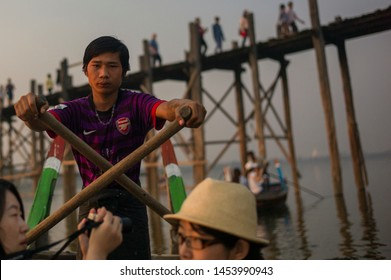 Mandalay, Myanmar- MAR 5: The boatman around U-Bein bridge  in Mandalay, Myanmar on March 5 2015. The U-Bein bridge is the longest teak bridge in the world, 1.2km length.