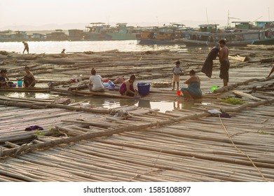 MANDALAY, MYANMAR - MAR 5: A shanty town built on bamboo poles tied together with locals going about their daily lives on the riverbank of the town of Mandalay, Myanmar on the 5 March 2015.