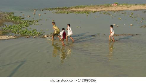 Mandalay, Myanmar- MAR 5: Unidentified Myanmar People in the lake by U-Bein bridge in sunset in Mandalay, Myanmar on March 5 2015.