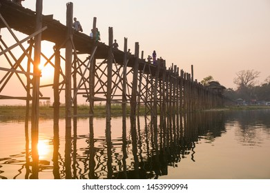Mandalay, Myanmar- MAR 5: Unidentified Myanmar People on U-Bein bridge in sunset in Mandalay, Myanmar on March 5 2015. The U-Bein bridge is the longest teak bridge in the world, 1.2km length.