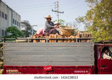 Mandalay, Myanmar - March 4 2015: People moving stuffs on the truck in Zegyo Market.