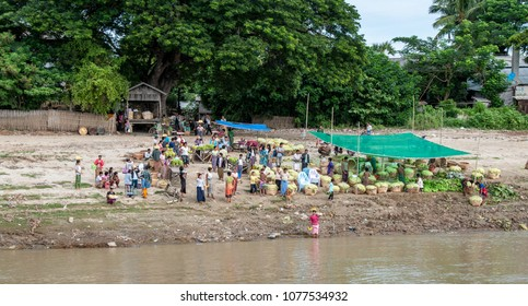MANDALAY, MYANMAR - NOV 4, 2012 : the farmers are waiting to load their vegetables on the line service boat on the Irrawaddy River, near Mandalay on November 4, 2012