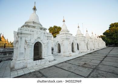 MANDALAY, MYANMAR- NOVEMBER 21 : The white pagoda land in Kuthodaw temple at Mandalay city in the evening on November 21, 2015 in Mandalay