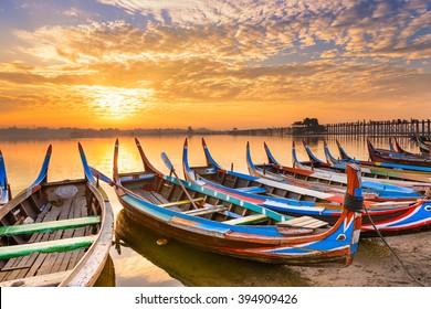 Mandalay, Myanmar on the Taungthaman Lake in front of U Bein Bridge.