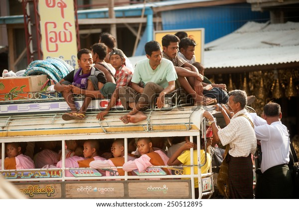 MANDALAY,MYANMAR - JULY 2 : unidentified Burmese peoples in a truck on July 2, 2014 in Mandalay city, Middle of Myanmar. Truck is a popular transportation in Myanmar because it can carry many people.