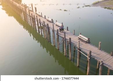 MANDALAY/MYANMAR(Burma)-30th September 2019:Students walking on the U Bein Bridge.