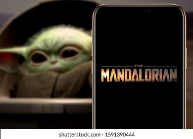 The Mandalorian logo smart phone that is a web television series.  United States, California January 6, 2020