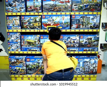 MANDALUYONG CITY, PHILIPPINES - JANUARY 21, 2018: A young boy looks at toys on display at a toy store in a shopping mall.
