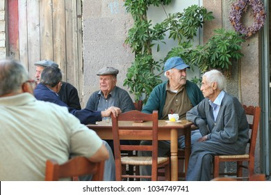 Mandamos Lesbos Greece September 2 2009 Old men drinking coffee and chatting at a cafe