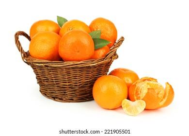 Mandarin in basket isolated on white