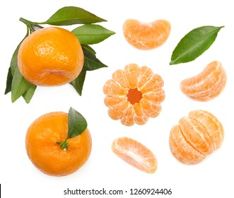 Mandarin with leaves, peeled mandarin and slices of mandarines isolated on white background. Top view.