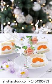 Mandarin orange sandwiches with prosciutto and romanesco cauliflower coktail salad