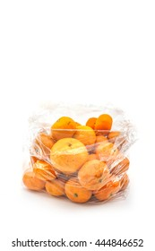 mandarin oranges in clear plastic bag isolated on white background with copy space