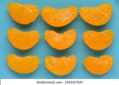 Mandarin oranges on light blue background