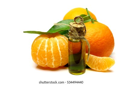 Mandarin, tangerine citrus fruit, with green leaf, isolated on white background. Cosmetic Essence, perfume oil natural plant product in a glass bottle. Pile of a fresh oranges citrus.