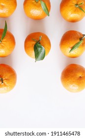 Mandarin, tangerine, clementine with leaves isolated on white background. Top view Natural food. Fruit for juices and jellies.