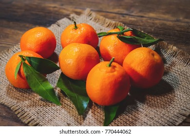 mandarins with leaves on a wooden table