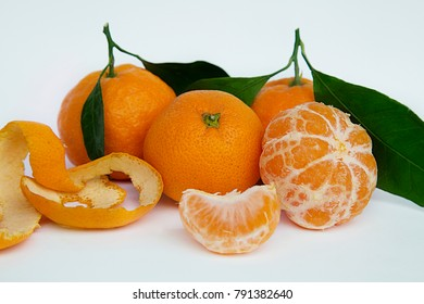 Mandarins with leaves and tangerine without peel isolated on white background