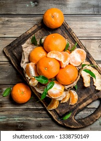 Mandarins on the cutting Board. On wooden background