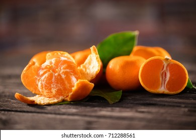 Mandarins. Tangerines close-up on a wooden background. Background tangerines