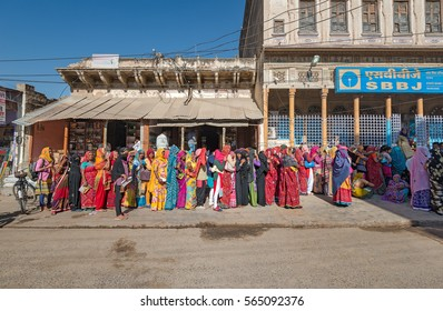 MANDAWA - DEC 22: people standing in long queue in front of bank on 22 December 2016 in Mandawa, India. Demonetization of Indian 500 and 1000 rupee notes caused long queues all over India.