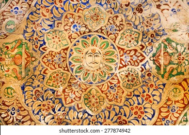 MANDAWA, INDIA - FEB 7: Face of sun in floral patterns on historical fresco in Shekhawati art style on February 7 2015. With popul. of 21000, Mandawa is a touristic site with naive art Haveli mansions