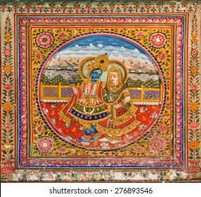 MANDAWA, INDIA - FEB 7: Lord Krishna playing the flute for his wife on a fresco with golden paint on February 7 2015. With popul. of 21000, Mandawa is a touristic site with its naive art Haveli houses