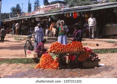 MANDAWA, INDIA - NOV 6, 2003 - Street vendor selling carrots and other vegetables near Mandawa, India