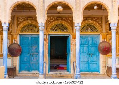 Mandawa, India - November 20, 2018: Interior of frescoed Haveli in Mandawa village, traditional ornately decorated residence, Rajasthan, India.