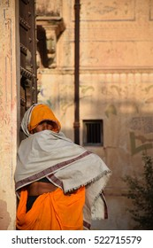 MANDAWA, RAJASTHAN, INDIA - FEBRUARY 14 - Indian woman with colorful dress inside an old traditional haveli