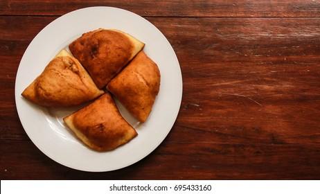 Mandazi, African Doughnut, on a plate.