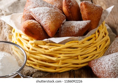 Mandazi or dabo, or South Sudanese Coconut Doughnut close up in the basket on the table. horizontal