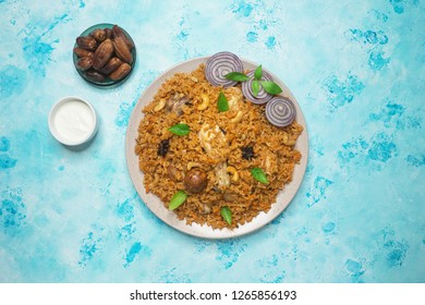 Mandi Kabsa - Arabian chicken with almond and rice. Chicken Kabsa.