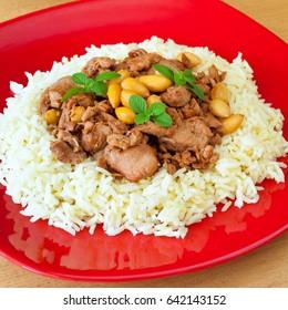 Mandi Kabsa -  Arabian chicken with almond and rice.