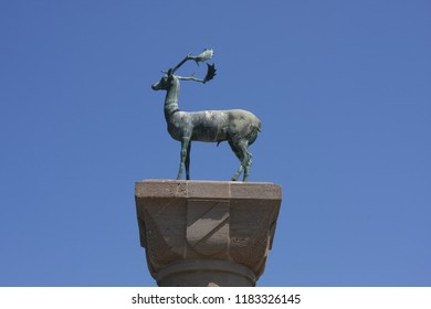 Mandraki harbor and bronze deer statues where the Colossus of Rhodes may have stood, Greece.