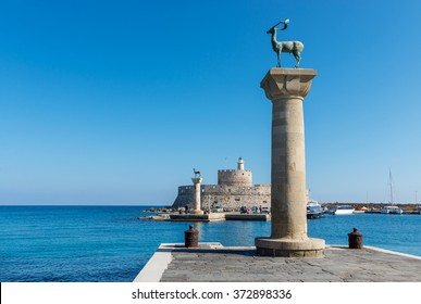 Mandraki harbor entrance, Rhodes Greece