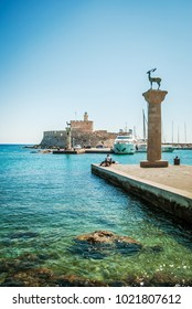 Mandraki port, with tourists and yachts in the harbor, Rhodes Island, Greece