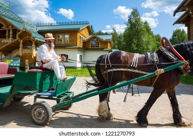 Mandrogi, Russia - July 10, 2013: Karelia Region, a bearded man in traditional dress on a carriage for tourists