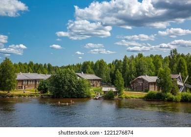 Mandrogi, Russia - July 10, 2013: Karelia Region,  old wooden houses on the Visir river and and local people taking bath