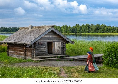Mandrogi, Russia - July 11, 2013: Karelia Region,  country girls in traditional dress walking in the village