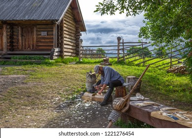 Mandrogi, Russia - July 11, 2013: Karelia Region,  a wood craftsman at work in the village