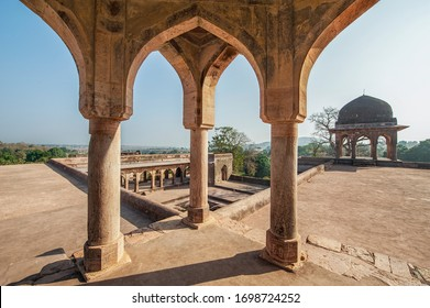 Mandu ,14 February, 2010:  Top view from terrace of Sultan Baz Bahadur Palace through arches  showing  pavilion dome and bathing pool below against blue sky, Mandu,Madhya Pradesh, India, Asia