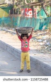 MANDU, INDIA - FEBRUARY 05, 2017 : Unidentified Indian poor child on the street. Poverty is a major issue in India