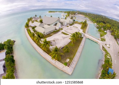 Maneaba ni Maungatabu (Parliament of Kiribati) building on motu in an atoll's  lagoon, aerial view. House of Assembly, Ambo, South Tarawa, Kiribati, Gilbert islands, Micronesia, Oceania.