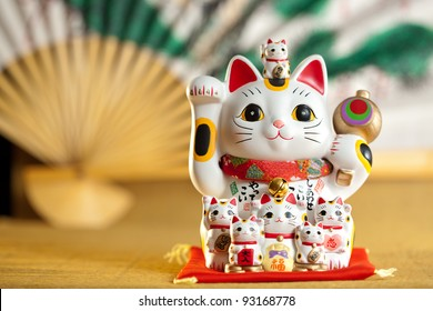 Maneki Neko cat. Common Japanese sculpture bring good luck to the owner.